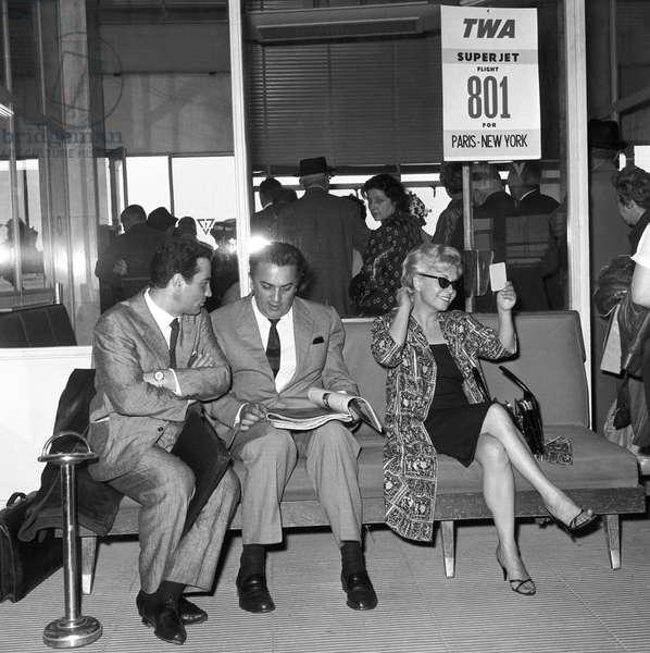 Giulietta Masina and Federico Fellini at Ciampino Airport, Italy, 1960 (b/w photo)