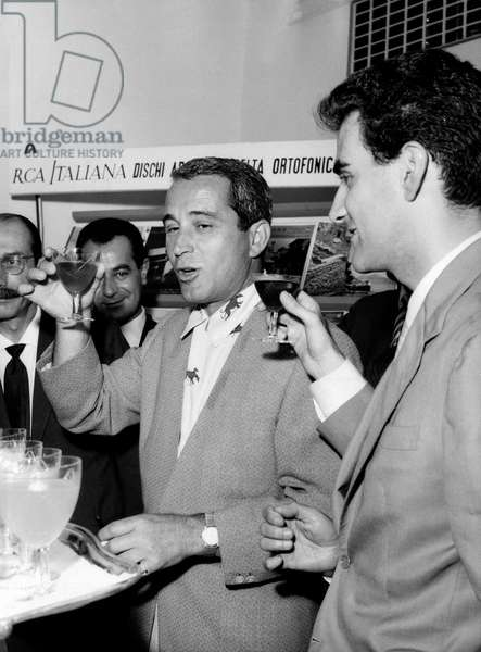 Perry Como and Teddy Reno cheers after a press conference at the RCA office in Rome, 1958 (b/w photo)