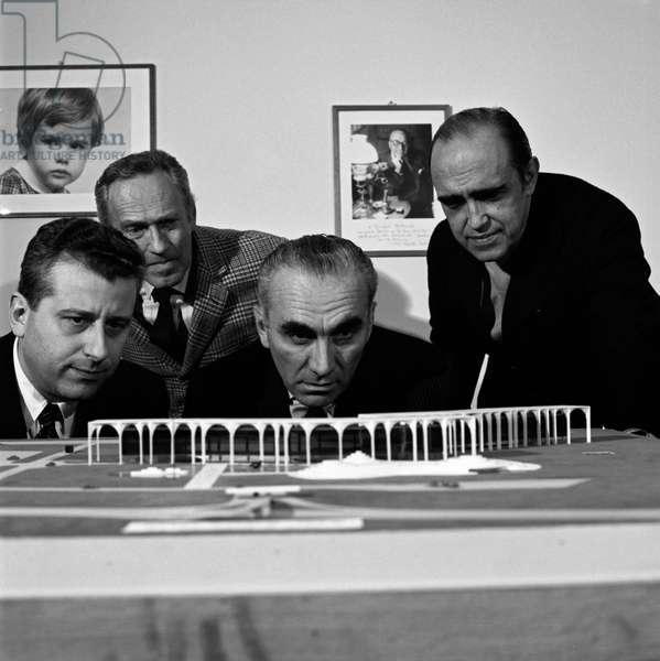 Oscar Niemeyer and Giorgio Mondadori seeing Palazzo Mondadori scale model, Segrate, Italy