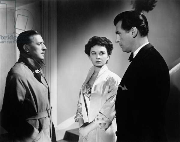 Jean Simmons, worried, listens to the conversation between Stewart Granger and Geoffrey Denton in the movie Adam and Evelyne