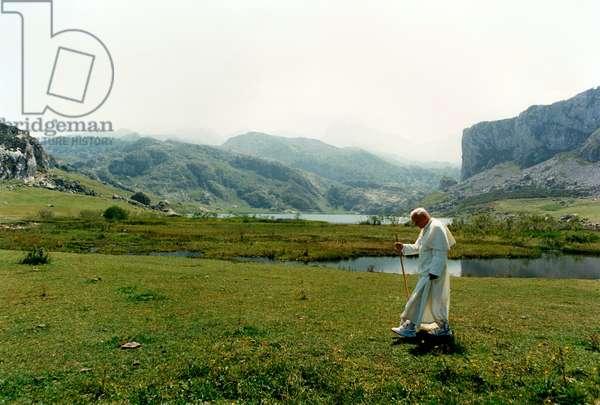Pope John Paul II walking in the grass