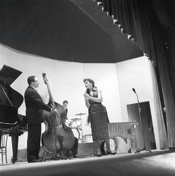 A singer perfoming during a concert by Chet Baker (b/w photo)