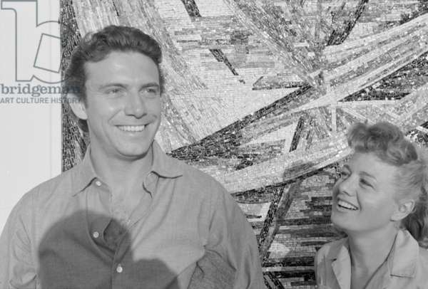 Shelley Winters and Anthony Franciosa beside a mosaic, Italy, 1958 (b/w photo)