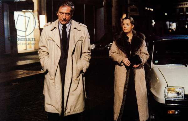 Yves Montand and Romy Schneider walking by night, France