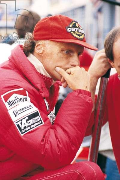 Niki Lauda looking thoughtful in the paddocks