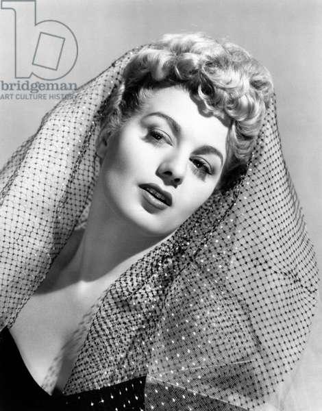 Shelley Winters wearing a veil on her head