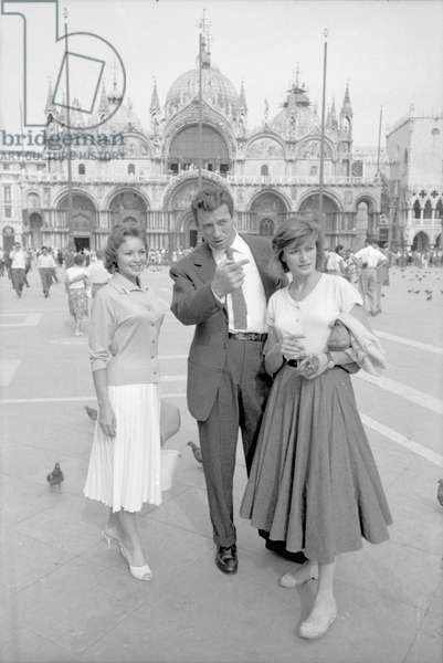 Yves Montand, Francoise Arnoul and Anouk Aimée in St Mark's square, Italy, 1955 (b/w photo)