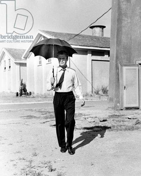 Marcello Mastroianni on La dolce vita's film set, 1959 (b/w photo)