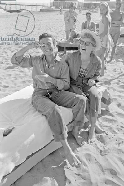 Shelley Winters and Anthony Franciosa at the beach, Italy, 1958 (b/w photo)