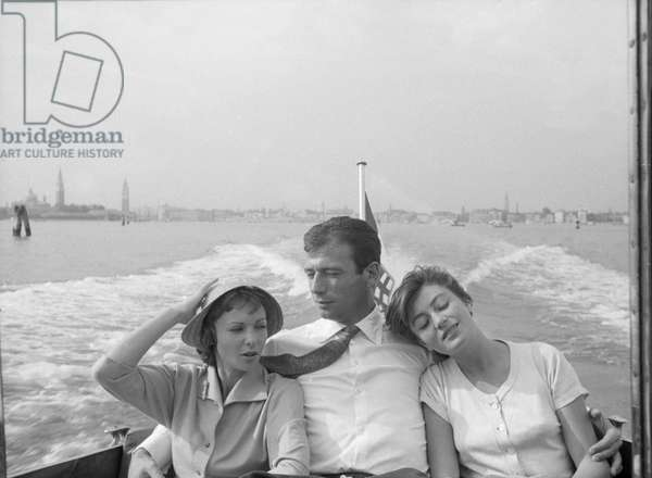 Yves Montand, Francoise Arnoul and Anouk Aimée on a boat, Italy, 1955 (b/w photo)