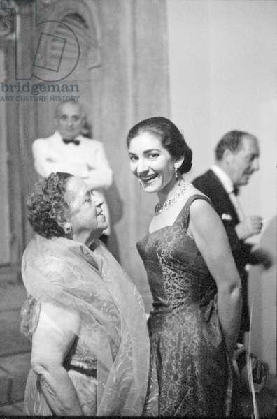 Maria Callas and Elsa Maxwell at a party, Italy, 1957 (b/w photo)