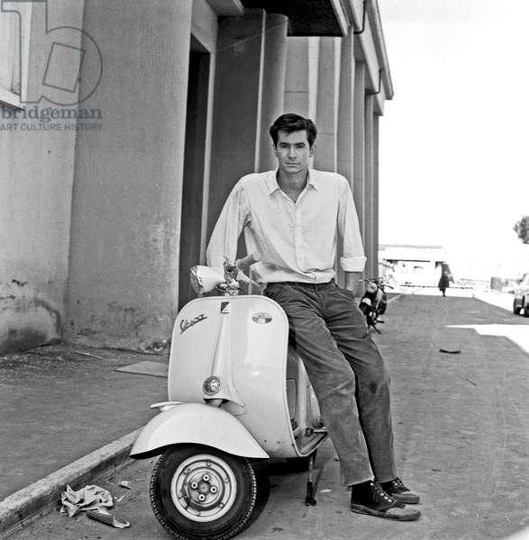 Anthony Perkins posing on a Vespa, Rome, Italy, 1957 (b/w photo)