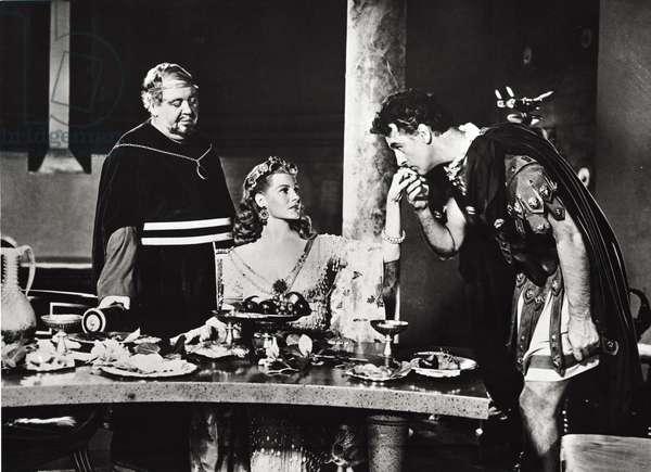 Stewart Granger, Rita Hayworth and Charles Laughton, 1953 (b/w photo)