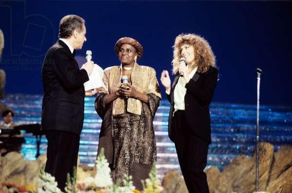 Johnny Dorelli, Miriam Makeba and Caterina Caselli on the stage of Sanremo Music Festival