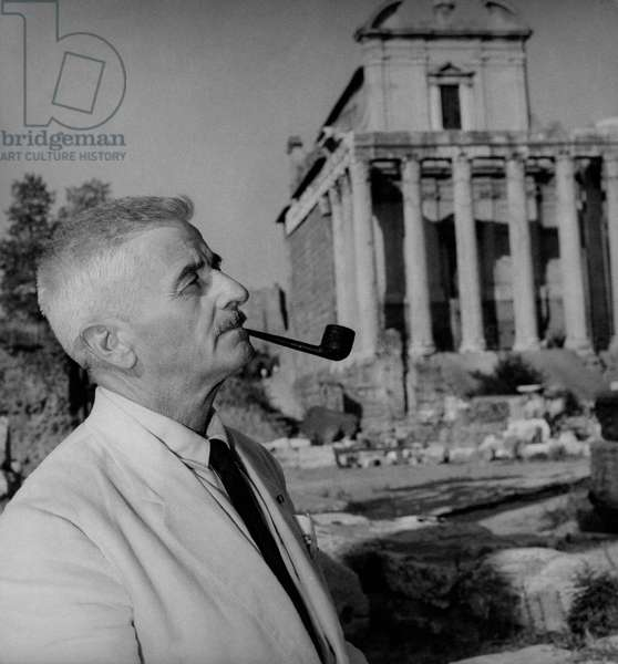 William Faulkner smoking a pipe in Rome