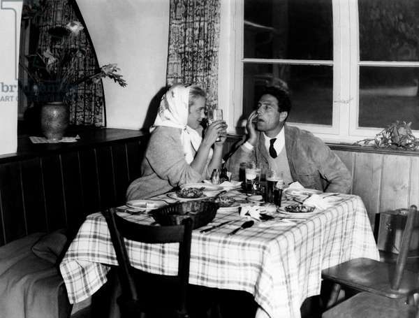 Maria Schell and Raf Vallone at dinner, 1956 (b/w photo)