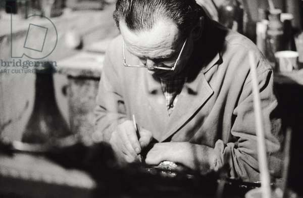 A gilder working, 1965 (b/w photo)
