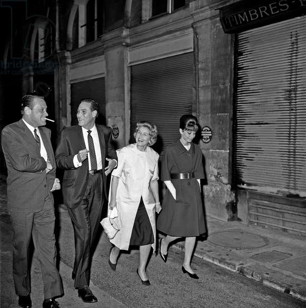 Audrey Hepburn, William Holden and Curd Jurgens walking in Paris, Paris, France, 1962 (b/w photo)