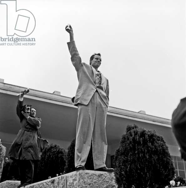 Charlton Heston greeting fans at Ciampino airport, Ciampino, Italy, 1958 (b/w photo)