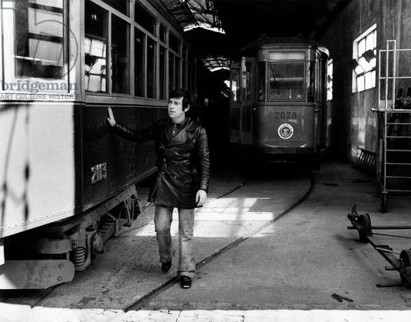 Enzo Cerusico beside a tram