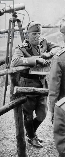 Victor Emmanuel III of Italy leaning on a fence