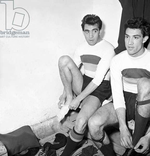Walter Chiari putting on a sock, Italy, 1951 (b/w photo)