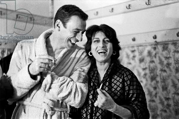 Yves Montand and Anna Magnani in the dressing room at Sistina theatre, Rome, Italy, 1959 (b/w photo)