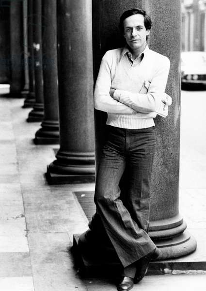 Roberto Bisacco leaning against a column