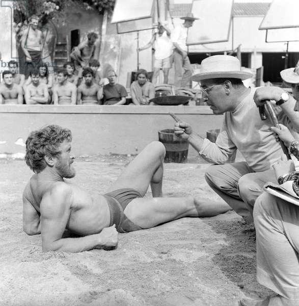 Mario Camerini and Kirk Douglas on the film set of Ulysses, Italy, 1953 (b/w photo)