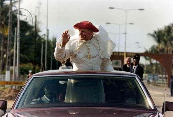 Pope John Paul II greeting from a car's sunroof
