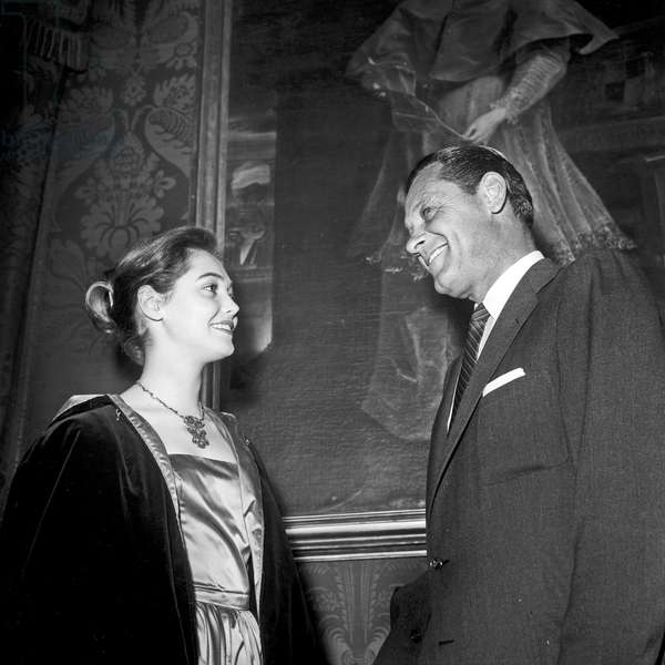 William Holden talking with a girl, Rome, Italy, 1957 (b/w photo)