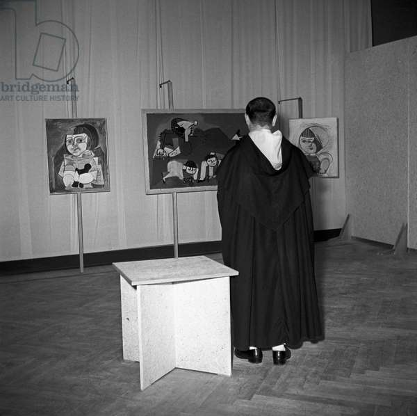A friar observing Picasso's paintings, Rome, Italy