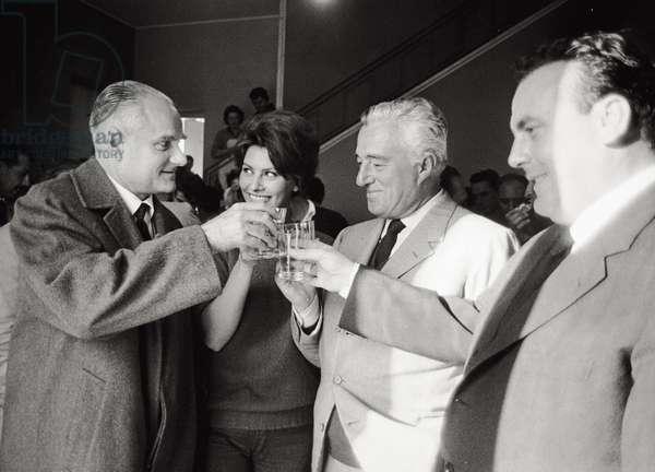 Sophia Loren is drinking a toast with Viittorio De Sica and Alberto Moravia, 1960 (b/w photo)
