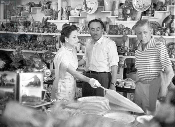 Wallis Simpson in a souvenir shop, Capri, Italy, 1952 (b/w photo)