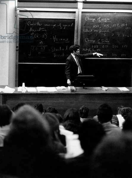 A professor teaching in a lecture hall