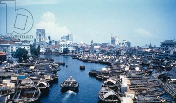 Boats sailing the River Singapore, Singapore, 1962 (b/w photo)