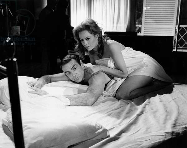 Sean Connery and Luciana Paluzzi together in a bed, 1965 (b/w photo)