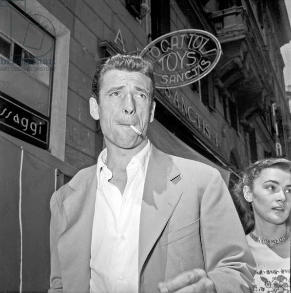 Yves Montand walking in Rome, Rome, Italy, 1950 (b/w photo)