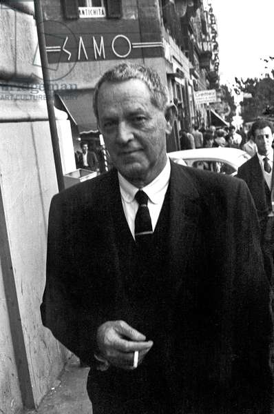 William Holden smoking a cigarette, Rome, Italy, 1969 (b/w photo)