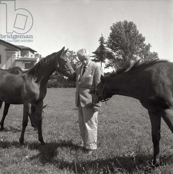 William Faulkner with horses (b/w photo)