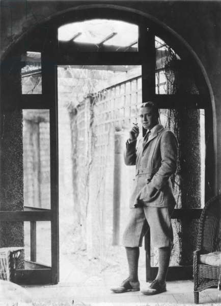 Francis Scott Fitzgerald smoking, 1920 (b/w photo)