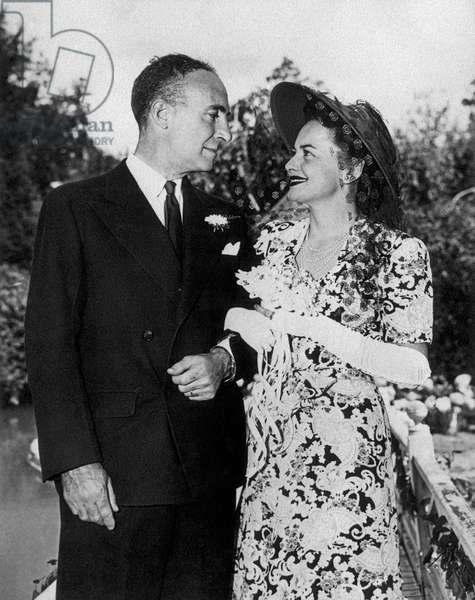 Olivia de Havilland and Pierre Galante smiling to each other