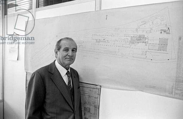 Portrait of Luigi Lucchini beside a plan