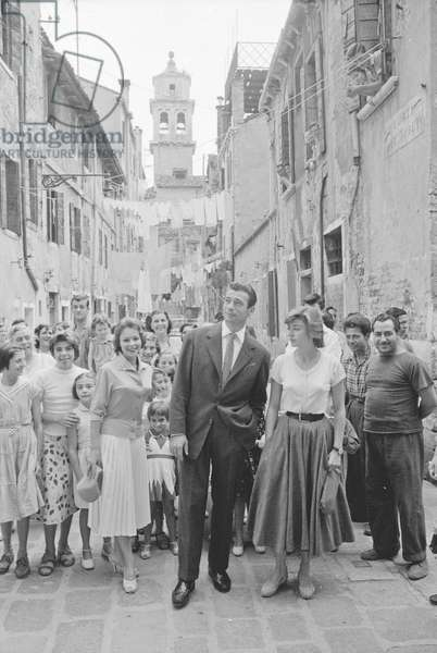 Yves Montand, Francoise Arnoul and Anouk Aimée surrounde by fans, Italy, 1955 (b/w photo)