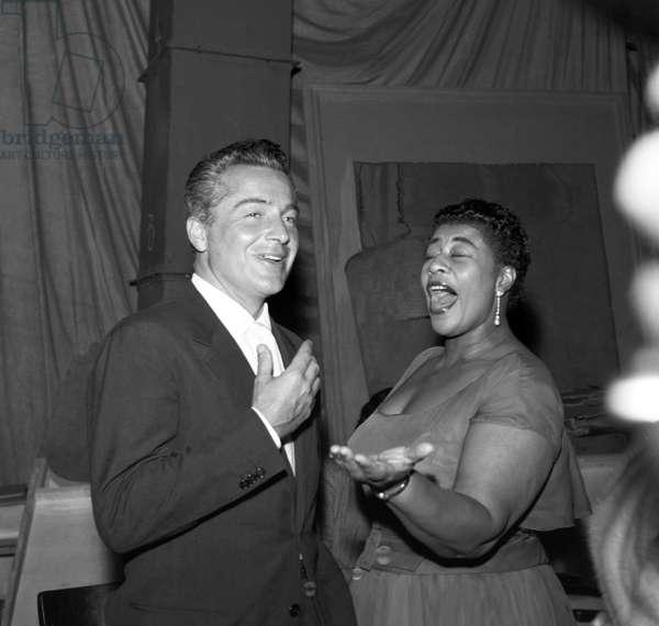 Rossano Brazzi singing with Ella Fitzgerald, Italy, 1957 (b/w photo)