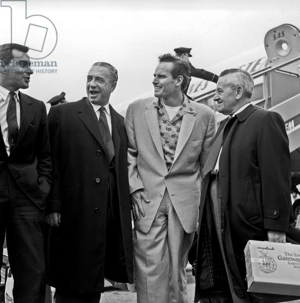 Charlton Heston and William Wyler arriving at Ciampino airport, Ciampino, Italy, 1958 (b/w photo)