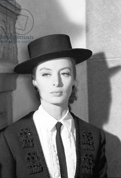 Capucine posing, 1963 (b/w photo)
