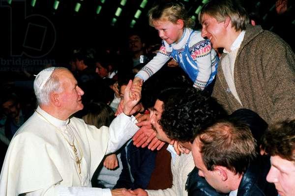 Pope John Paul II greeting a child, Vatican City, Vatican City State