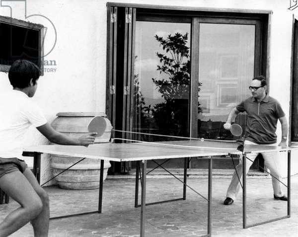 Ennio Morricone with his son, 1970 (b/w photo)