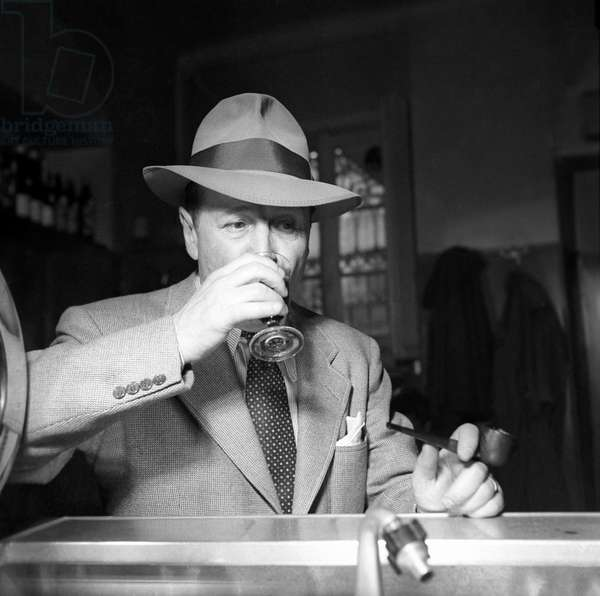 Georges Simenon drinking a glass of wine,  Milan, Italy